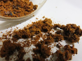 Signs of a cigarette beetle infestation in chili powder. The larvae live in silken sacs spun inside the spice, which they eat as food. Picture credit: Joe Ballenger