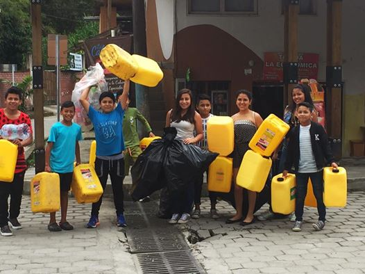 Kids are bringing drinkable water to affected areas.