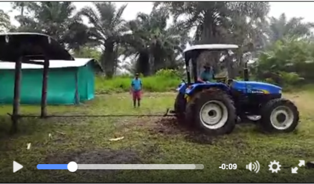Even the tractor can't pull it down. Watch the video here.